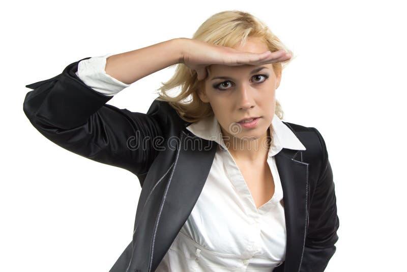 Donna di affari che esamina la distanza fotografia stock libera da diritti