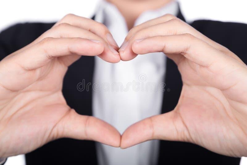 Donna di affari che fa forma del cuore con le sue mani fotografia stock