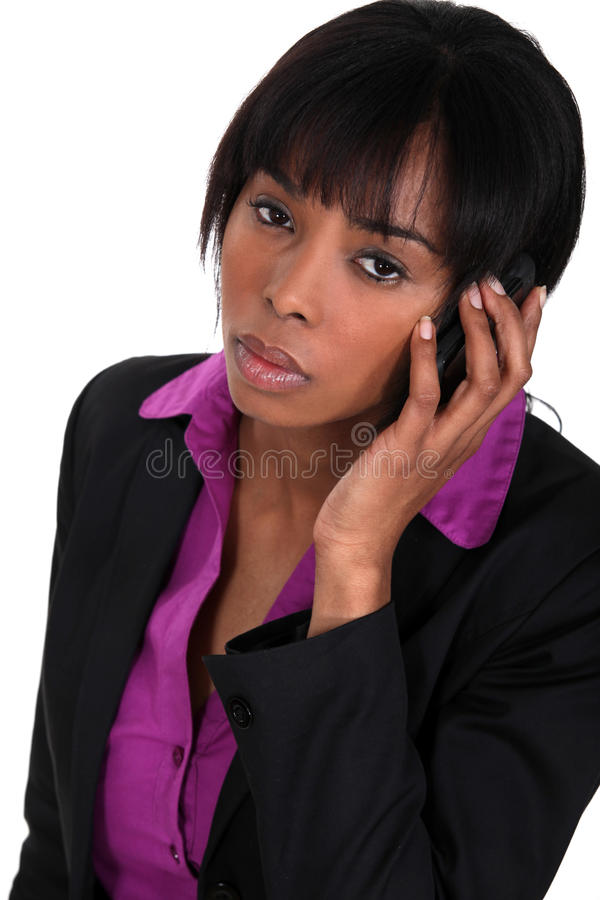 Donna di affari che fa una chiamata immagini stock