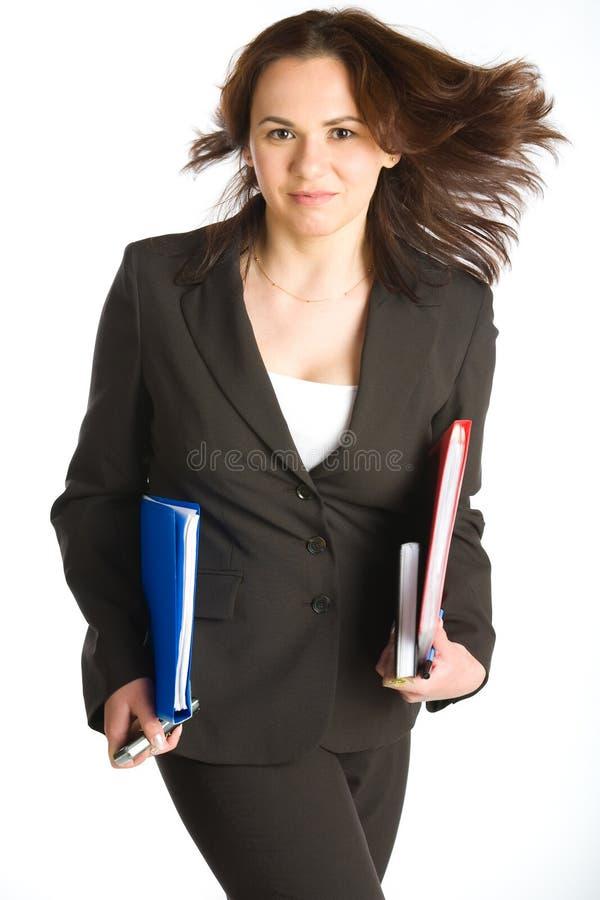 Donna di affari che funziona dal tempo immagine stock