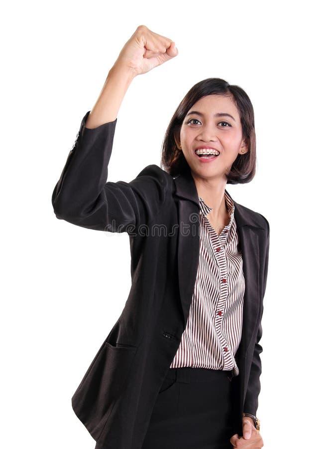 Donna di affari che gesturing ottimismo, su bianco fotografia stock libera da diritti