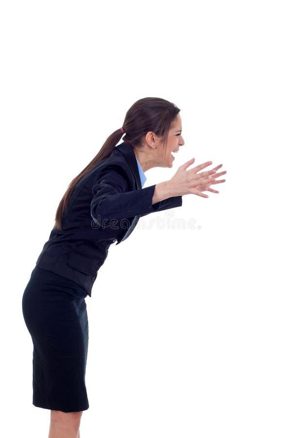 Donna di affari che grida ad un lato fotografia stock