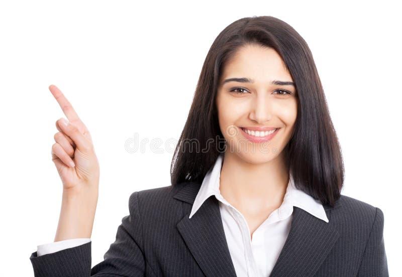 Donna di affari che indica al fondo bianco fotografia stock libera da diritti