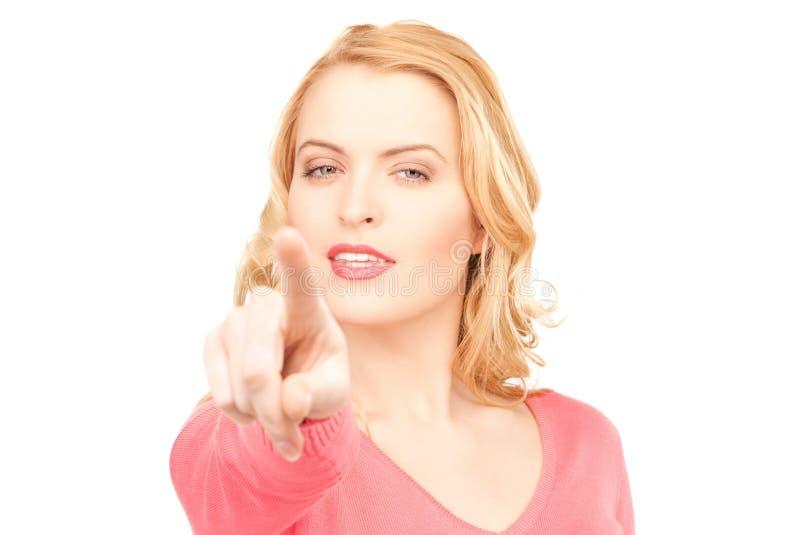 Donna di affari che indica la sua barretta immagini stock libere da diritti