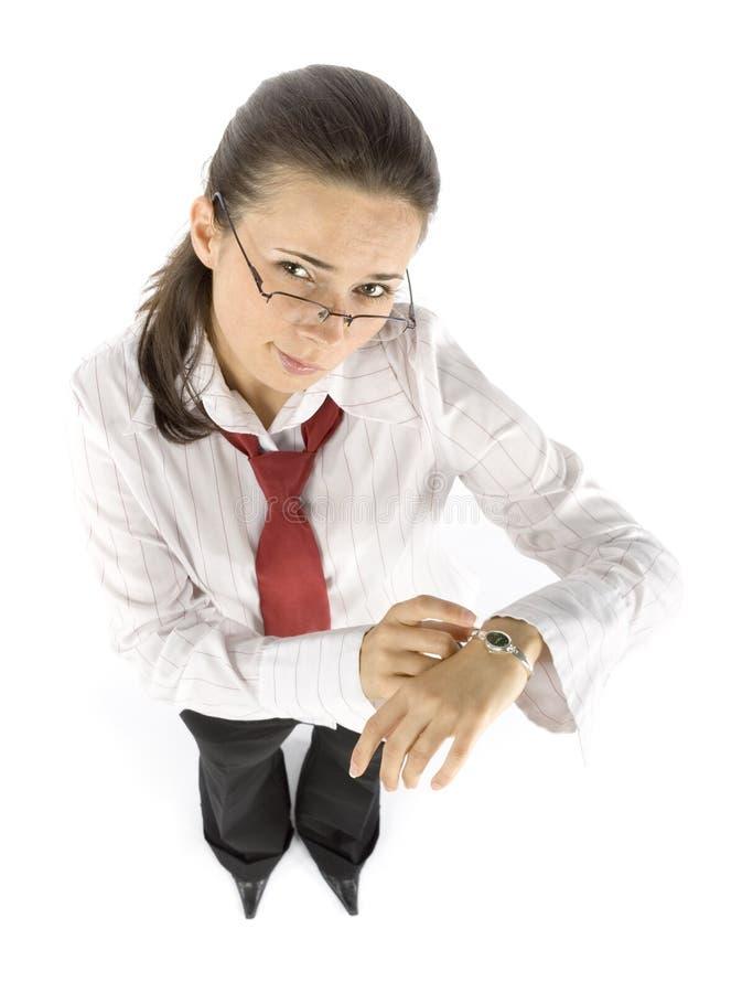 Donna di affari che indica vigilanza immagini stock