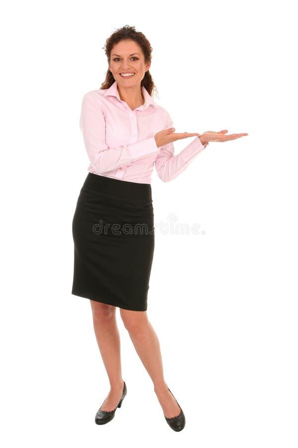 Donna di affari che introduce qualcosa fotografie stock