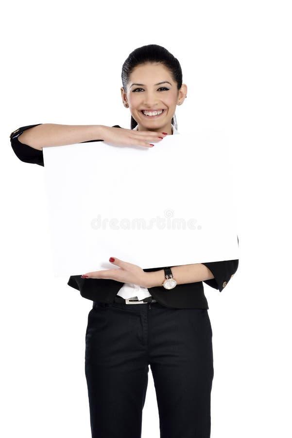 Donna di affari che mostra segno in bianco fotografia stock libera da diritti