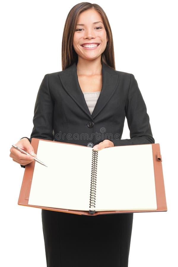 Donna di affari che scrive il copyspace in bianco del taccuino   immagini stock libere da diritti