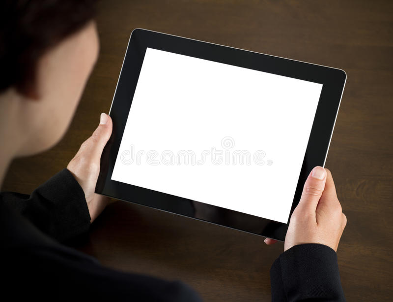 Donna di affari che tiene il PC in bianco del ridurre in pani fotografia stock