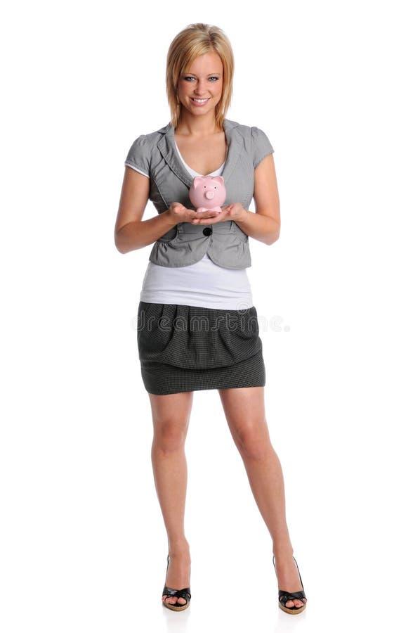 Donna di affari che tiene la Banca Piggy fotografia stock