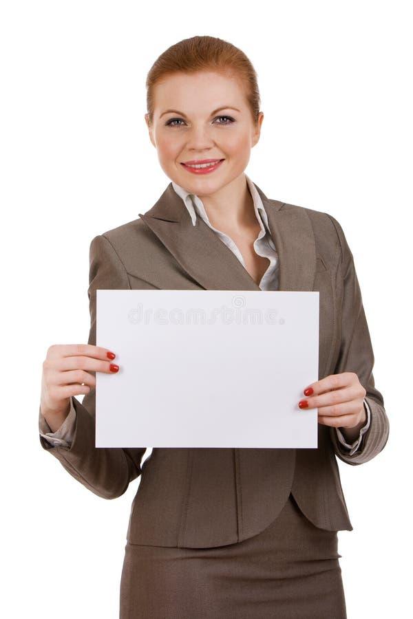 Donna di affari che tiene segno in bianco fotografia stock
