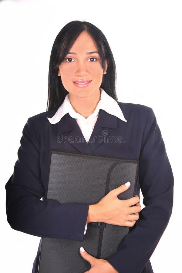 Donna di affari che tiene un dispositivo di piegatura fotografia stock libera da diritti