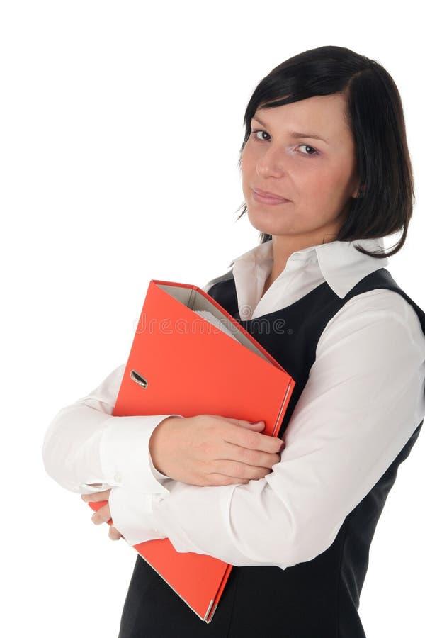 Donna di affari che tiene un raccoglitore fotografia stock