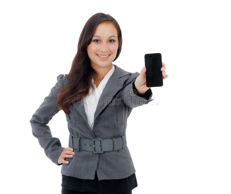 Donna di affari che tiene un telefono cellulare fotografia stock