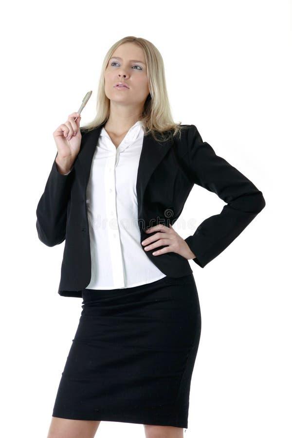 Donna di affari che tiene una penna fotografie stock