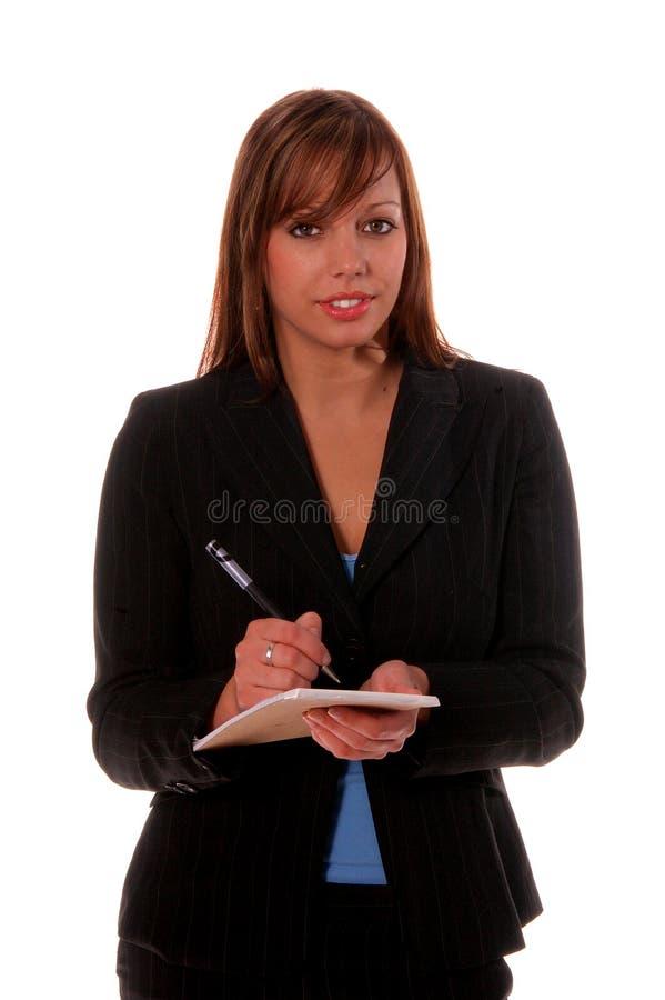 Donna di affari con il blocchetto per appunti fotografie stock
