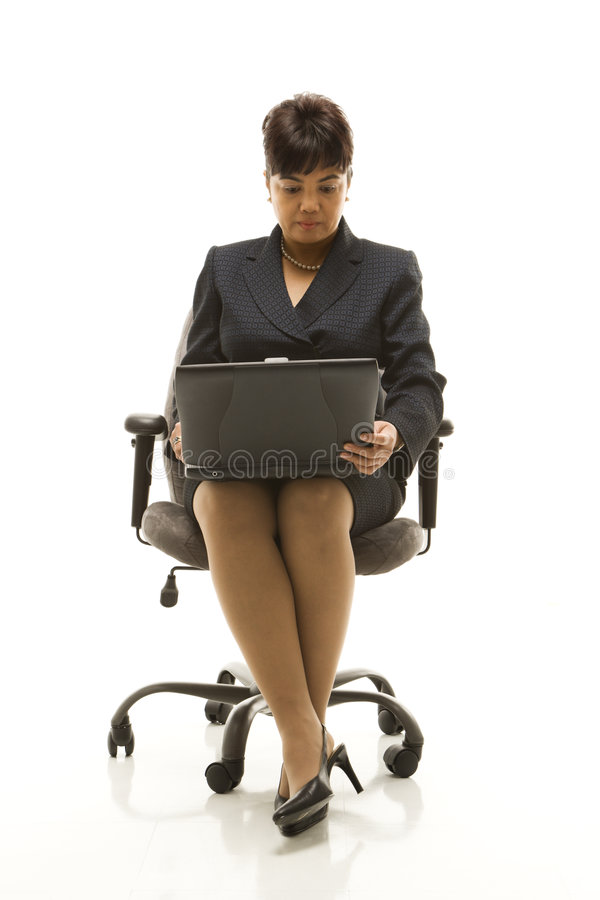 Donna di affari con il computer portatile. fotografie stock libere da diritti