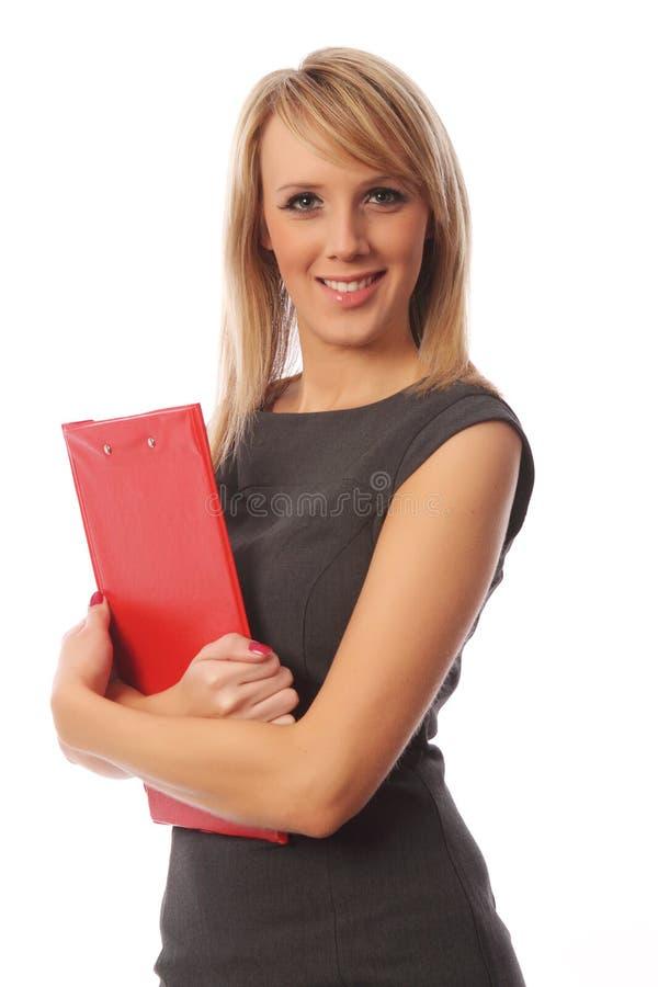 Donna di affari con il dispositivo di piegatura rosso fotografia stock libera da diritti