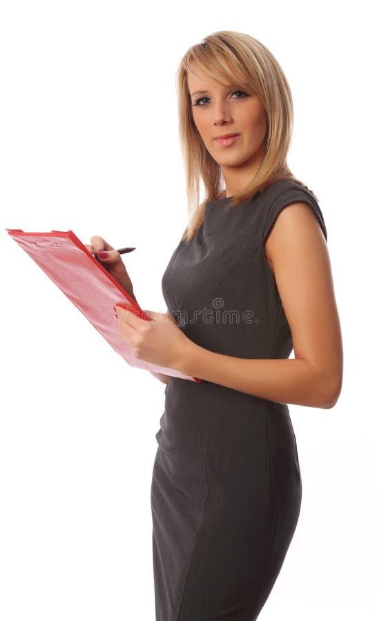 Donna di affari con il dispositivo di piegatura rosso immagini stock