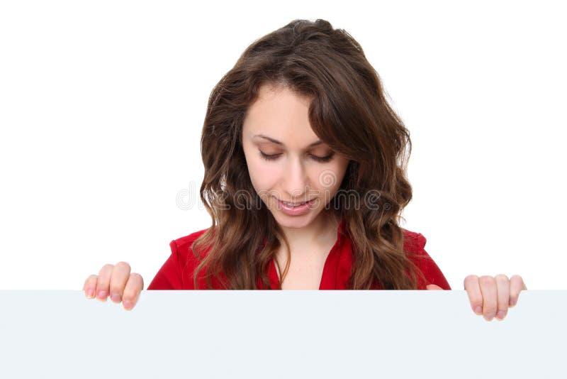 Donna di affari con il segno fotografia stock