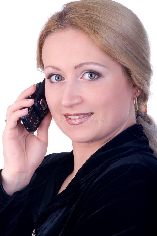 Donna di affari con il telefono immagine stock