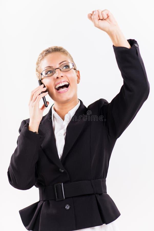 Donna di affari con il telefono cellulare fotografia stock
