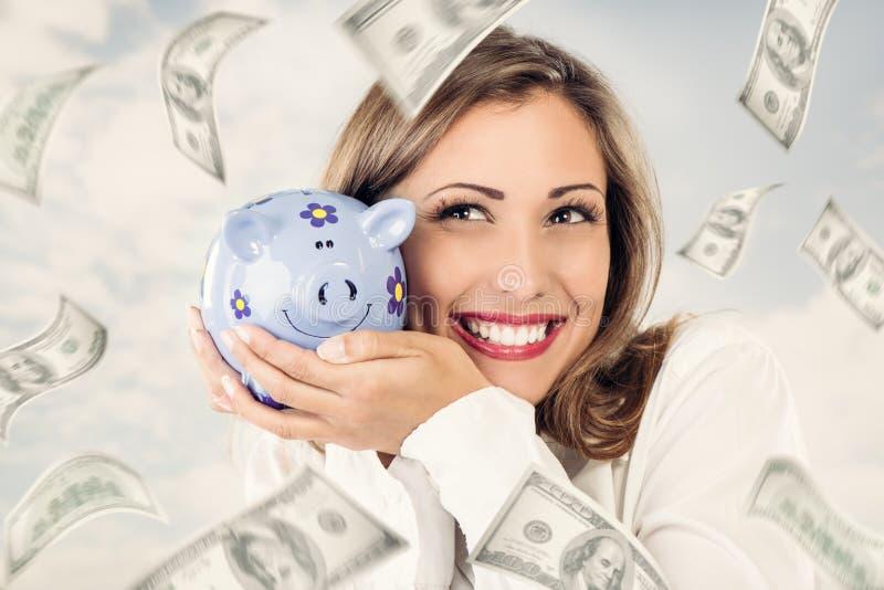 Donna di affari con la banca piggy fotografie stock