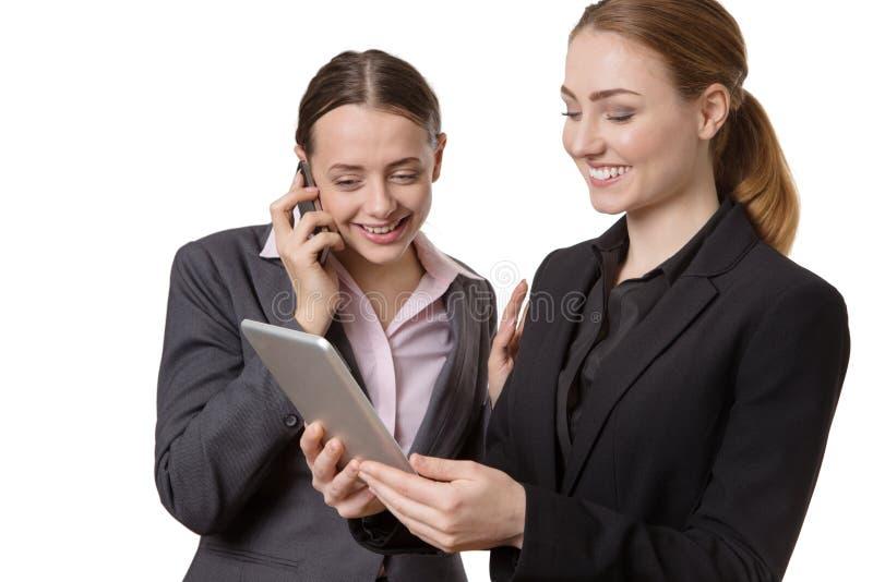 Donna di affari con la compressa ed il telefono fotografie stock