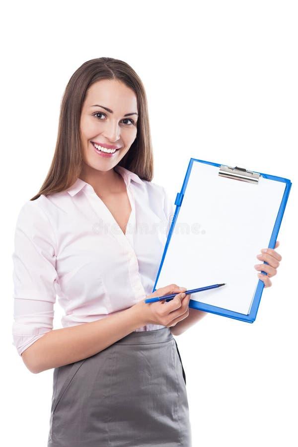 Donna di affari con la penna e la lavagna per appunti fotografia stock libera da diritti
