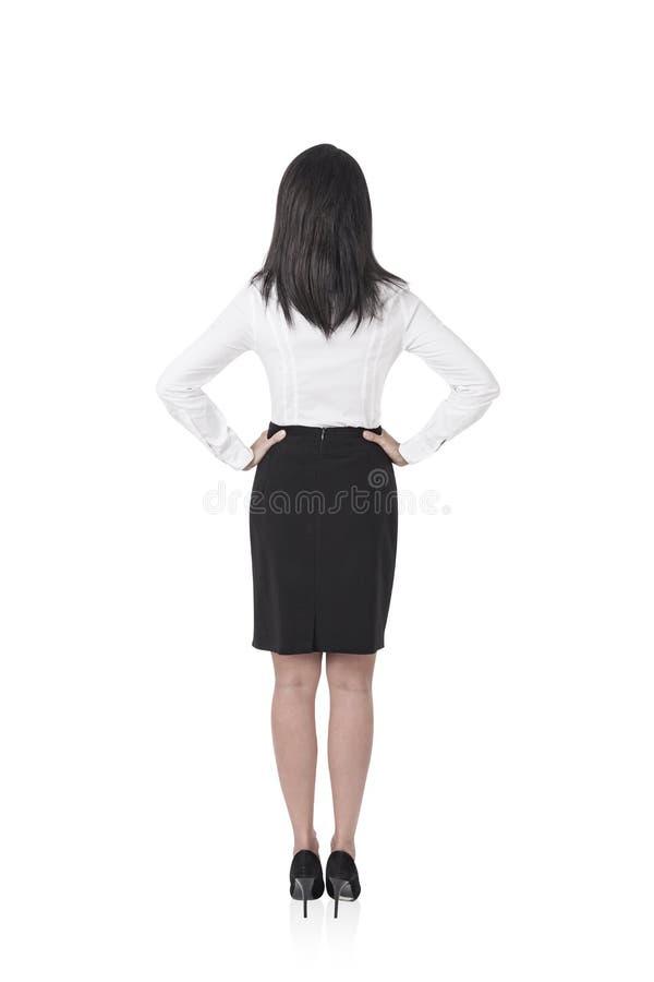 Donna di affari con le mani sulla vita, isolata fotografie stock