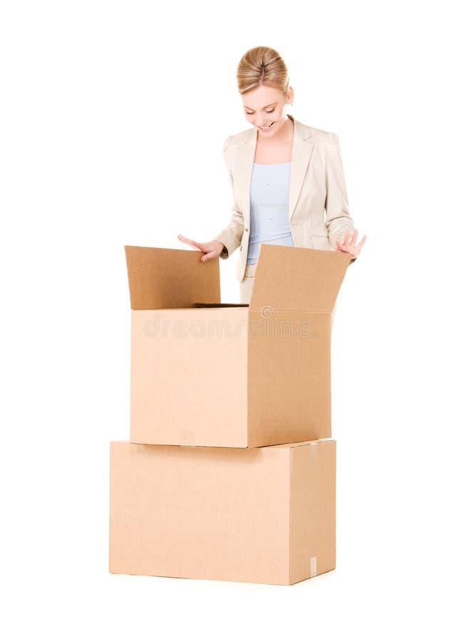 Donna di affari con le scatole fotografia stock