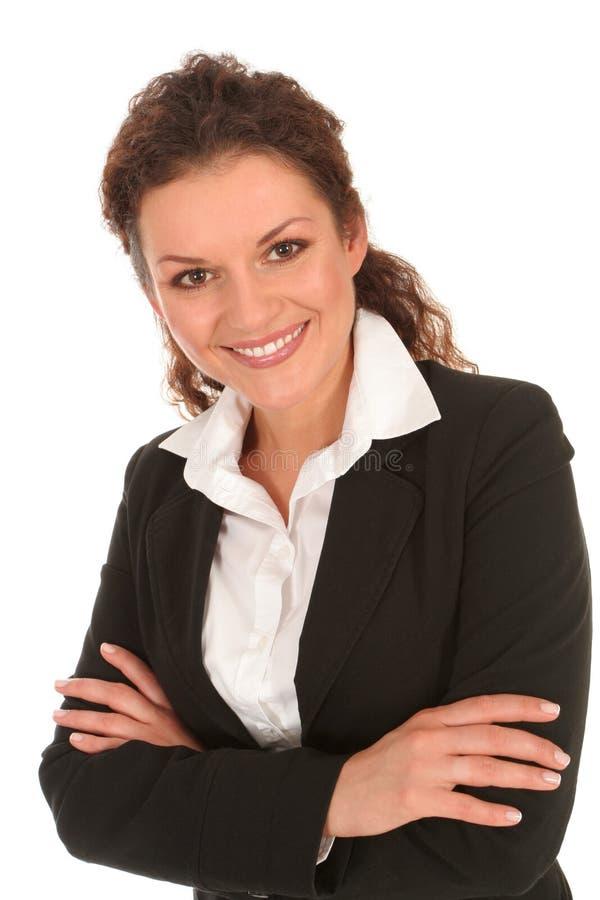 Donna di affari con le sue braccia attraversate immagini stock