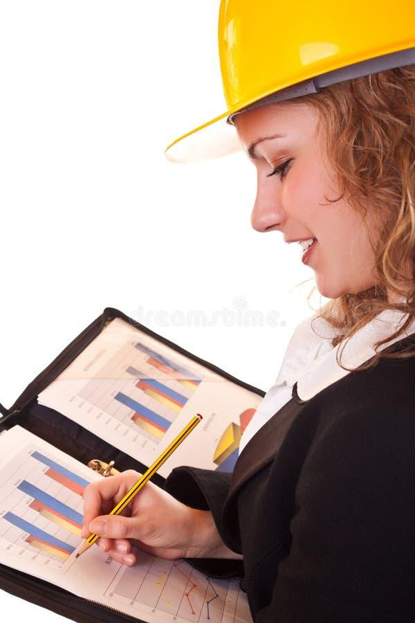 Donna di affari con scrittura del casco fotografie stock libere da diritti