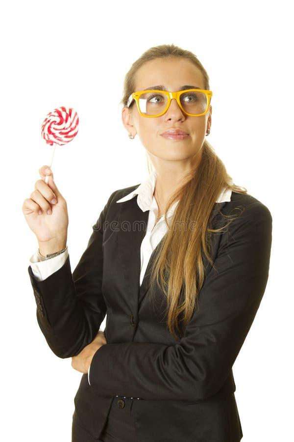 Donna di affari con un lollipop fotografie stock