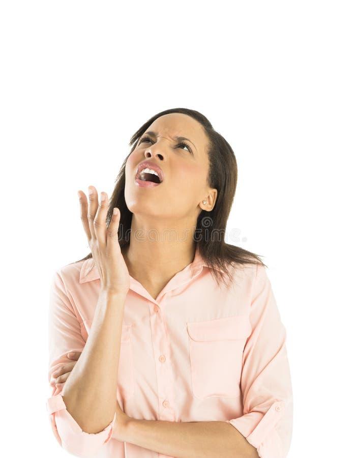 Donna di affari confusa Looking Up fotografie stock libere da diritti