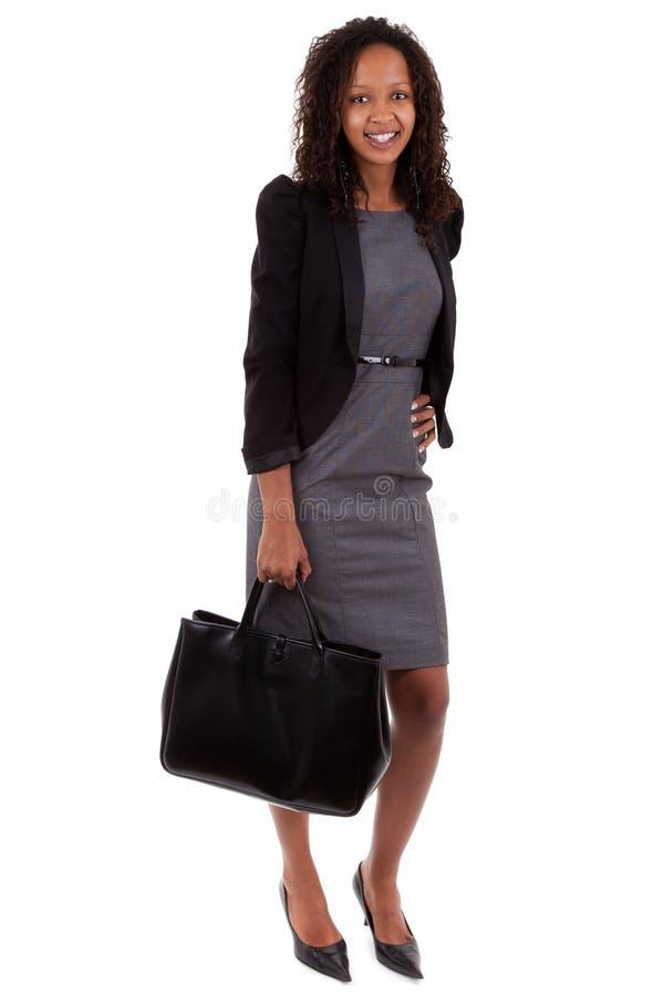 Donna di affari dell'afroamericano che tiene una borsa fotografia stock