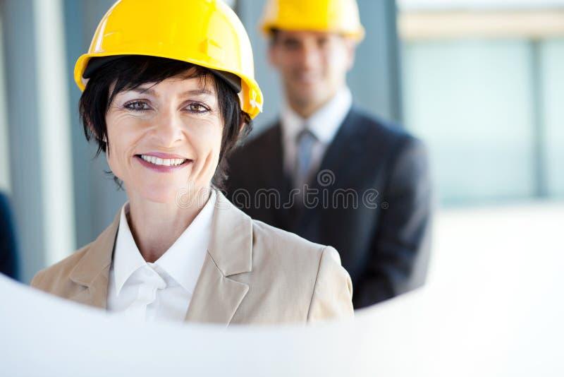 Donna di affari della costruzione fotografia stock libera da diritti