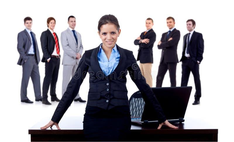 Donna di affari e la sua squadra fotografia stock