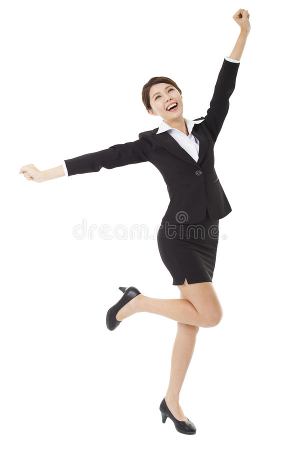 Donna di affari felice che salta e che balla immagini stock