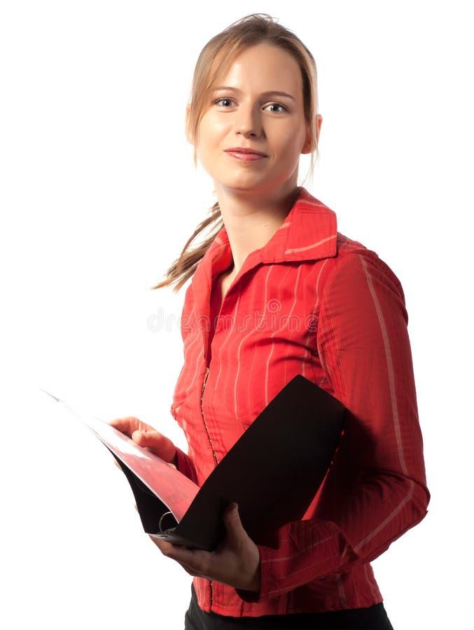 Donna di affari felice con il dispositivo di piegatura immagine stock libera da diritti