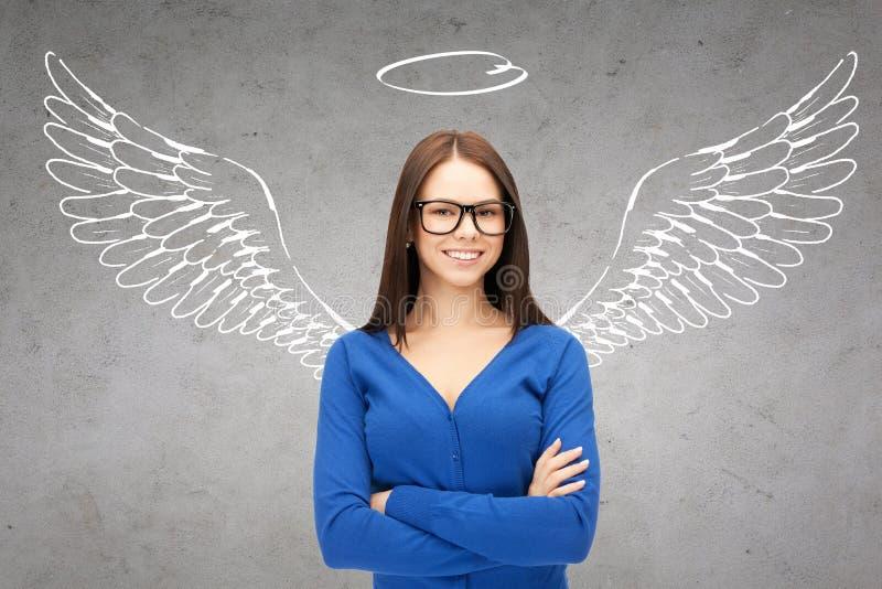 Donna di affari felice con le ali e nimbus di angelo immagine stock libera da diritti
