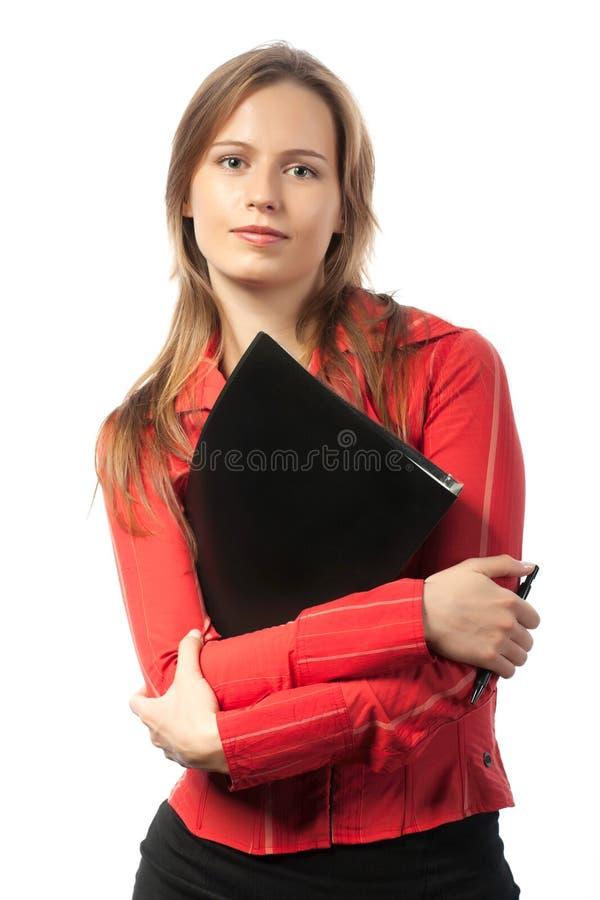 Donna di affari graziosa con il dispositivo di piegatura fotografia stock libera da diritti