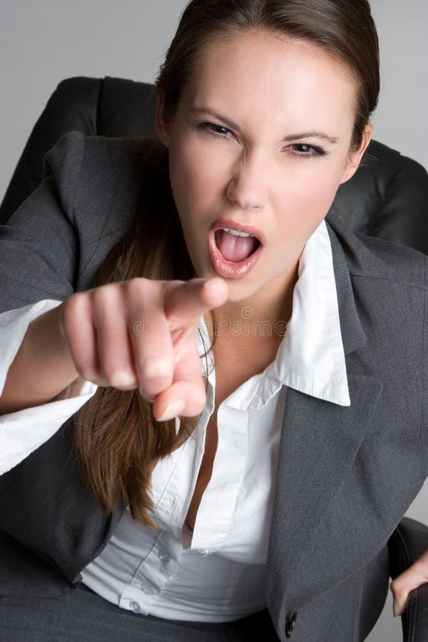 Donna di affari indicante pazza fotografia stock
