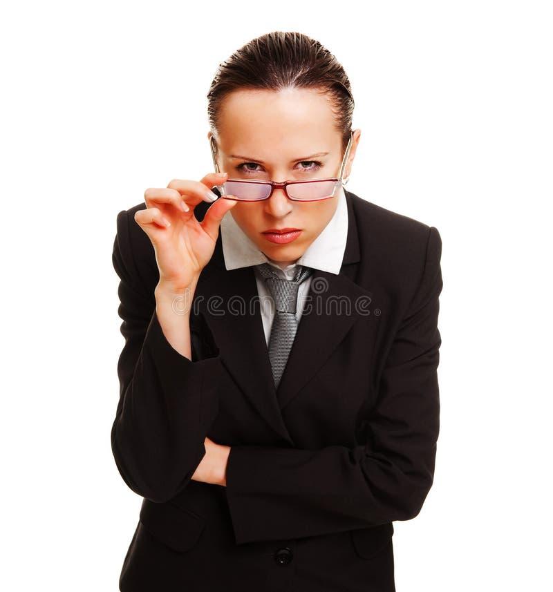 Donna di affari severa che guarda immagini stock