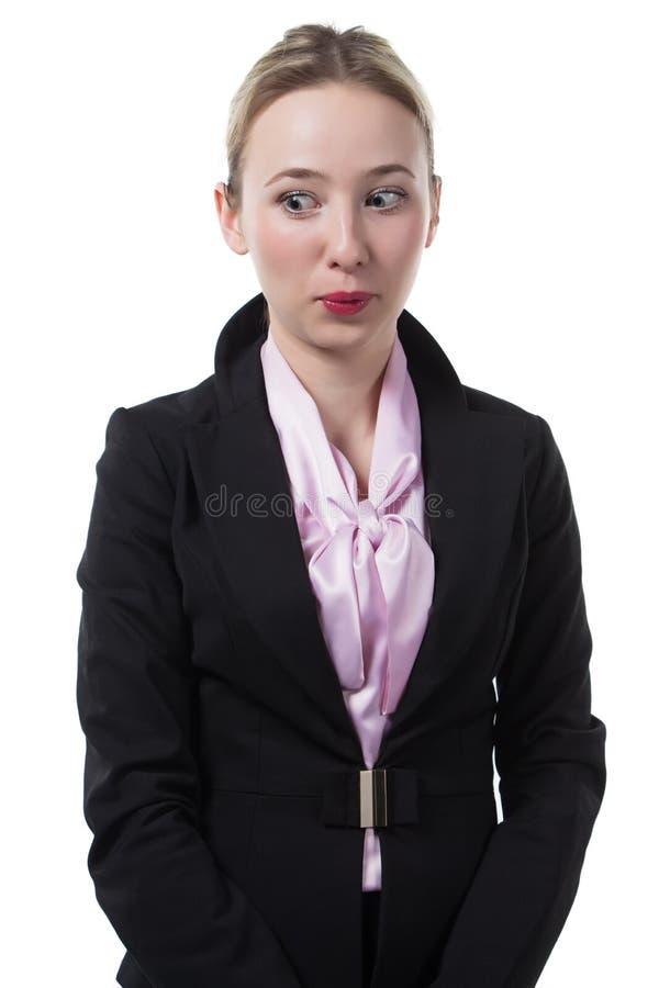 Donna di affari sorpresa che guarda indietro fotografia stock libera da diritti