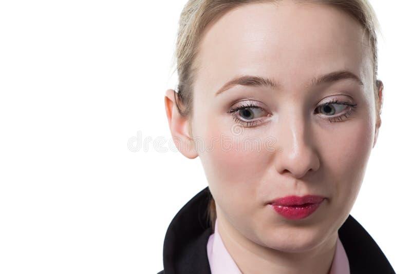Donna di affari sorpresa che guarda indietro fotografia stock