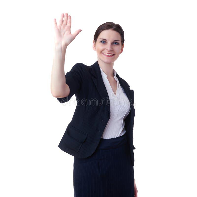 Donna di affari sorridente che controlla fondo isolato bianco fotografia stock