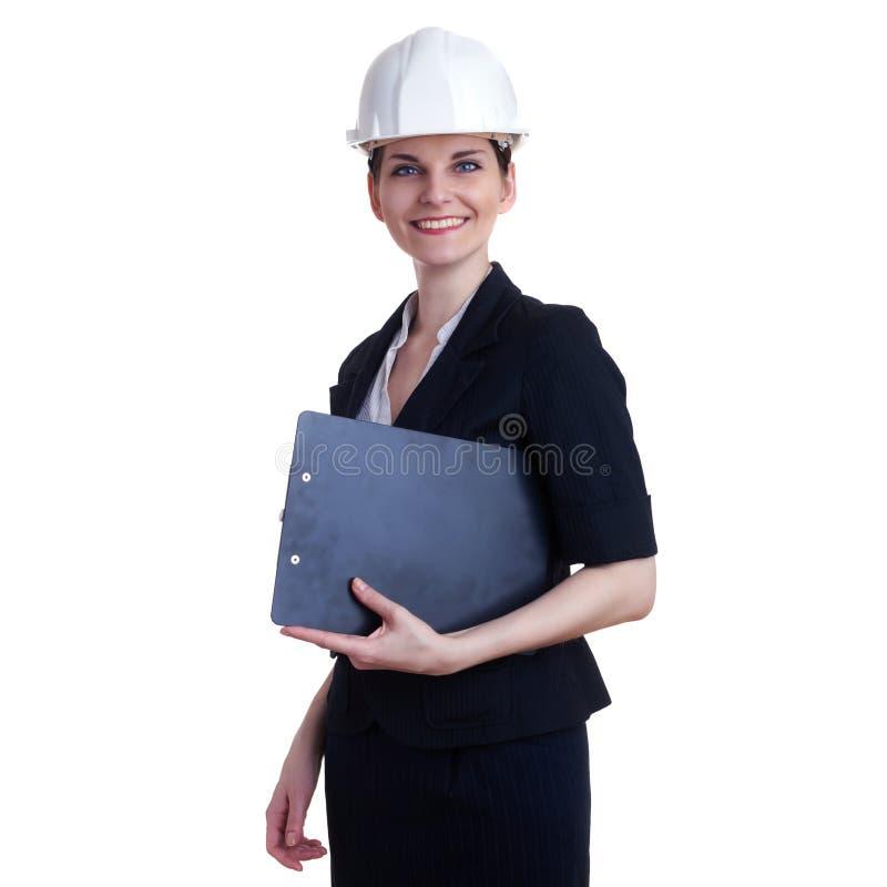 Donna di affari sorridente che controlla fondo isolato bianco immagine stock libera da diritti
