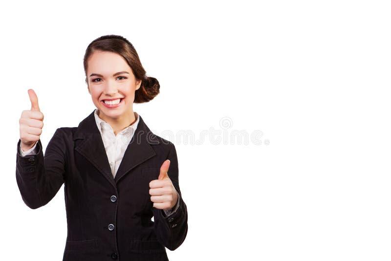 Donna di affari sorridente felice con i pollici sul gesto, isolato su fondo bianco fotografia stock