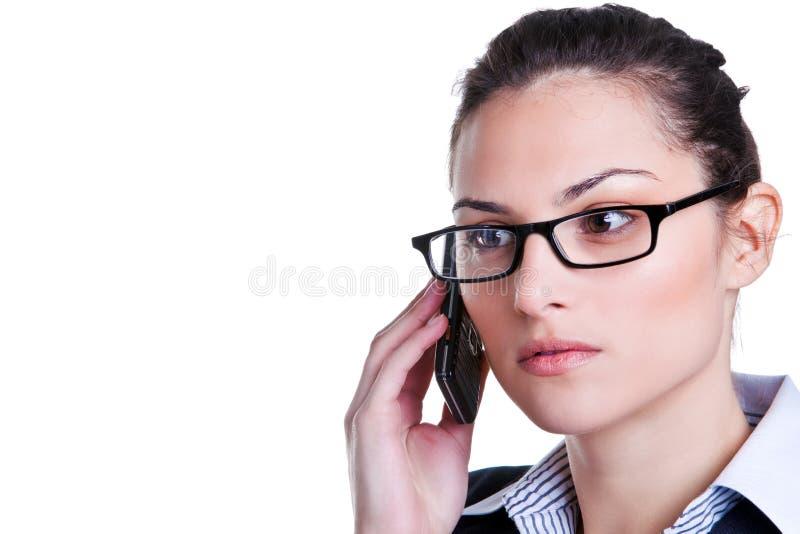 Donna di affari su un telefono mobile fotografie stock